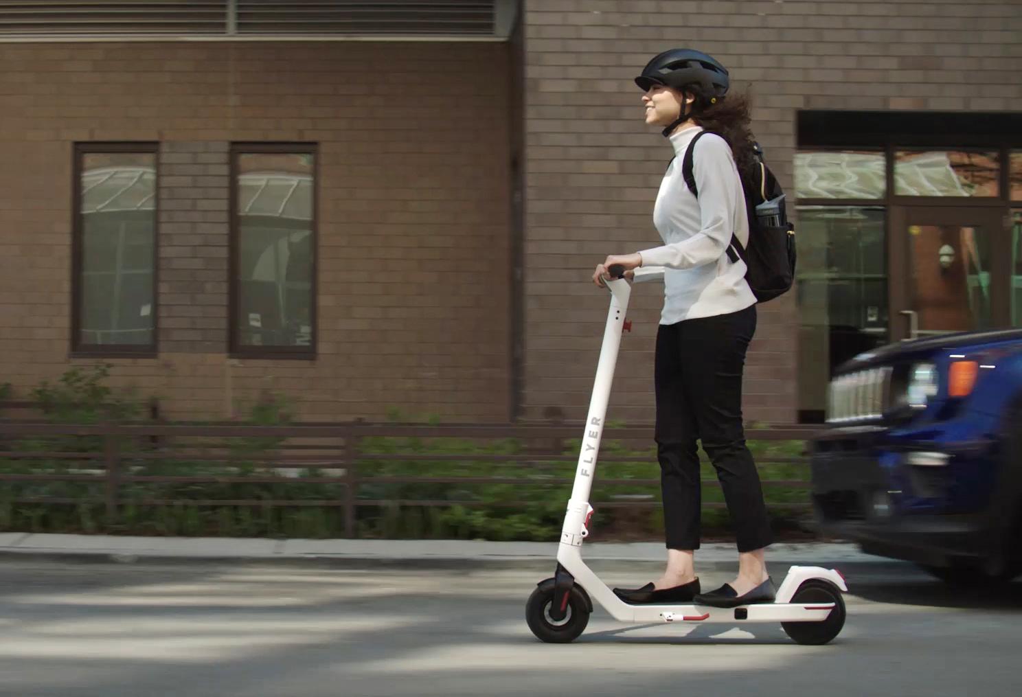 Girl Riding eScooter